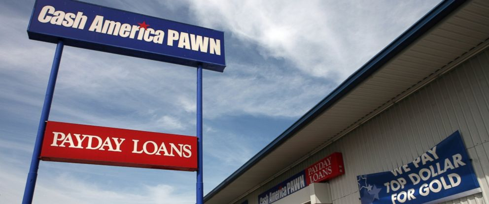 PHOTO:Signs seen at a Cash America pawn shop advertise payday loans and gold purchasing in this undated file photo.