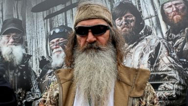 PHOTO: Reality TV personality Phil Robertson greets fans in the Duck Commander Compound at Texas Motor Speedway, April 5, 2014, in Fort Worth, Texas.