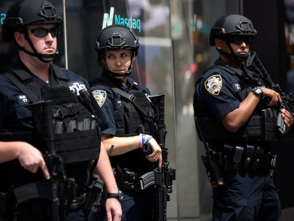 PHOTO: Members of the New York City Police Department stand guard in Times Square, July 15, 2016 in New York City.
