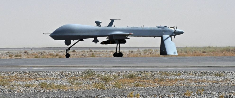 PHOTO A US Predator Unmanned Drone Armed With Missile Stands On The Tarmac Of