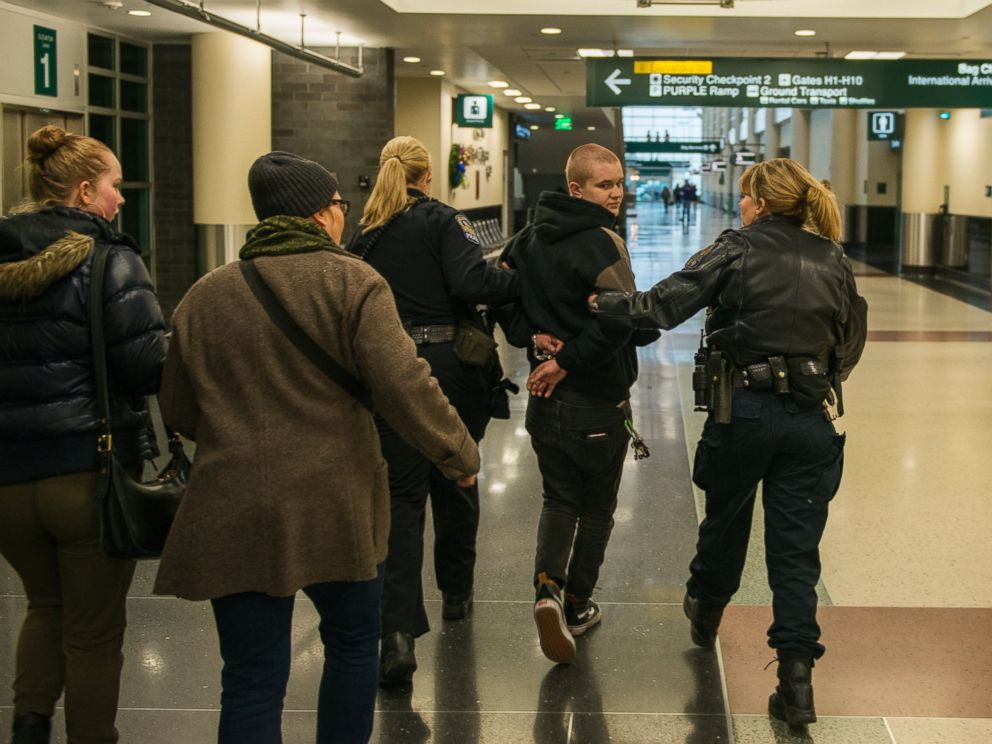 PHOTO: A woman, arrested at a Black Lives Matter protest at the Minneapolis-St. Paul International Airport, is walked by police to a detainment room, Dec. 23, 2015 in Minneapolis.