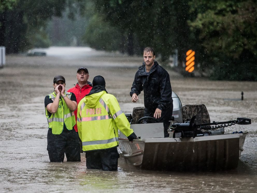 PHOTO: Residents and first responders launch boats to rescue people trapped in their homes, Oct. 4, 2015, in Columbia, S.C.