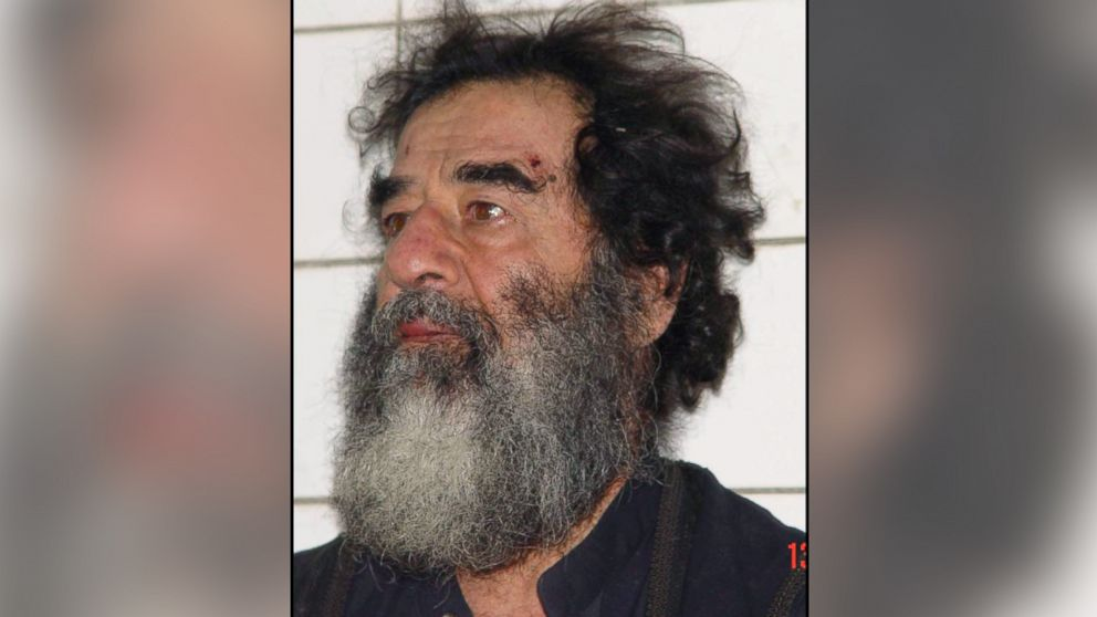 A handout photo of Saddam Hussein after his capture in Iraq, Dec. 14, 2003.