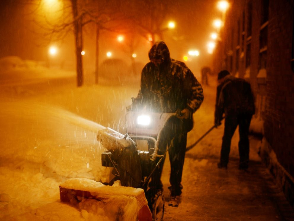 PHOTO: NEW YORK, NY - JANUARY 23: Crews clear sidewalks during a day of constant snow fall on January 23, 2016 in New York City.
