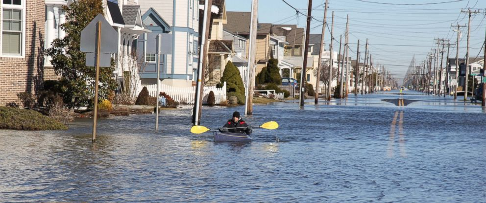 PHOTO: Max Sorensen, 23, paddles through his flooded neighborhood in Stone Harbor, N.J., Jan. 24, 2016.