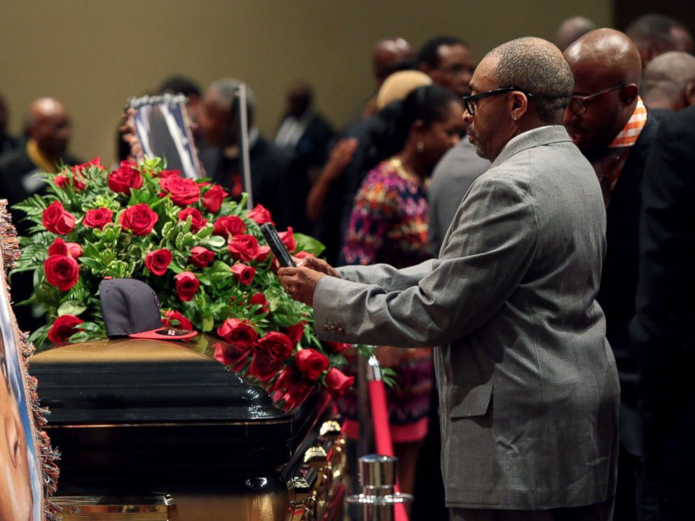 PHOTO: Director Spike Lee takes a picture of a black St. Louis Cardinals baseball cap that rests on top of the casket of Michael Brown inside Friendly Temple Missionary Baptist Church awaiting the start of his funeral on Aug. 25, 2014 in St. Louis Mo.