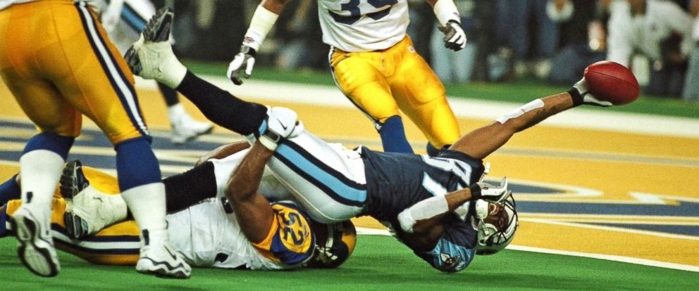 PHOTO: Tennessee Titans receiver Kevin Dyson is tackled just short of the goal line by St. Louis Rams linebacker Mike Jones on the last play of Super Bowl XXXIV at the Georgia Dome in Atlanta, Jan. 30, 2000. The Rams beat the Titans 23-16.