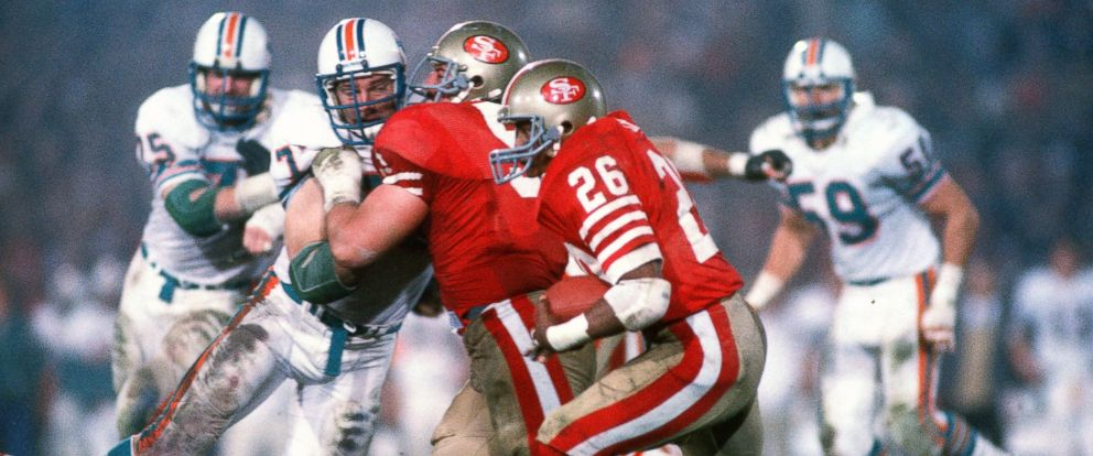 PHOTO: Wendell Tyler #26 of the San Francisco 49ers carries the ball against the Miami Dolphins during Super Bowl XIX, Jan. 20, 1985, at Stanford Stadium in Palo Alto, Calif.