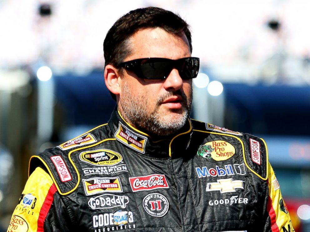 PHOTO: Tony Stewart walks in the garage area during practice for the NASCAR Sprint Cup Series Quaker State 400 on June 27, 2014 in Sparta, Ky.