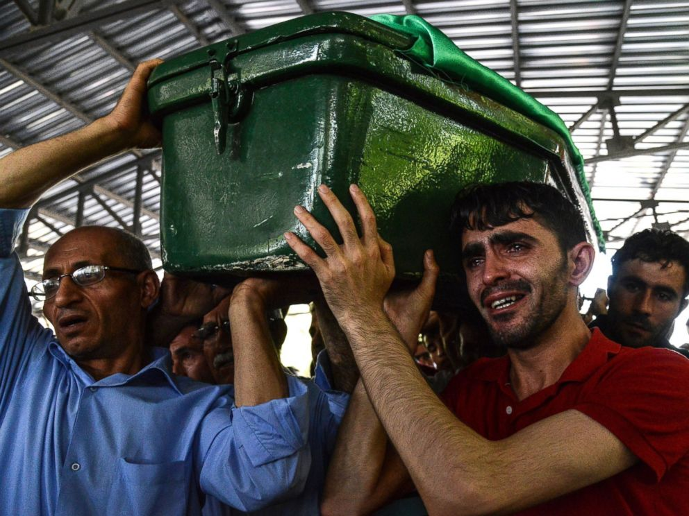 PHOTO: A man cries as he carries a coffin during a funeral for victims of the attack on a wedding party that left 50 dead in Gaziantep in southeastern Turkey near the Syrian border, Aug. 21, 2016.