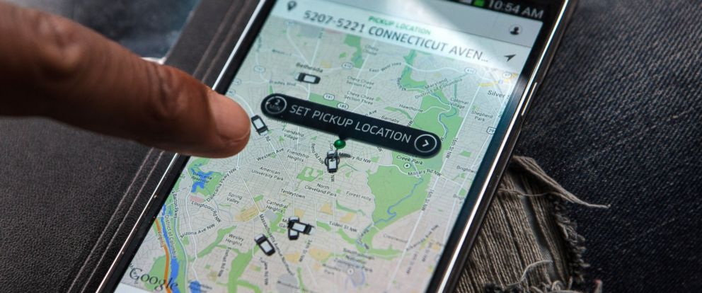 PHOTO: An UberX driver checks the Uber customer app, April 7, 2014, in Washington.