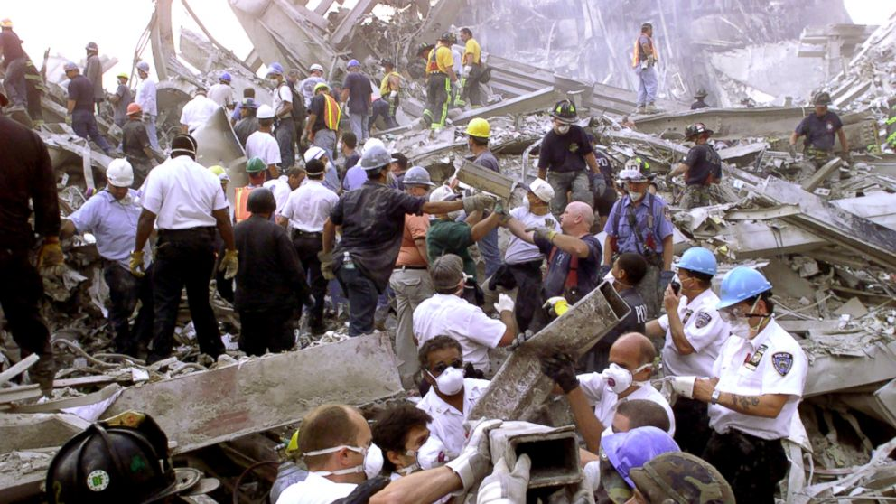 Rescue workers remove rubble at the World Trade Center after it was struck by a commercial airliner in a terrorist attack.