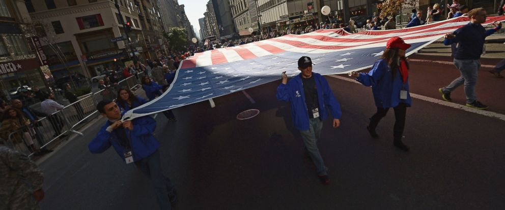 PHOTO: Parade participants representing The Wounded Warriors Project carry the American flag for the Veterans Day, November 11, 2012 in New York.