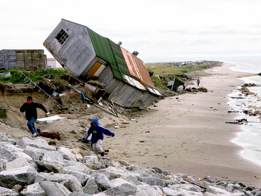 PHOTO: A home destroyed by beach erosion tips over in the the Alaskan village of Shishmaref, Sept. 27, 2006.
