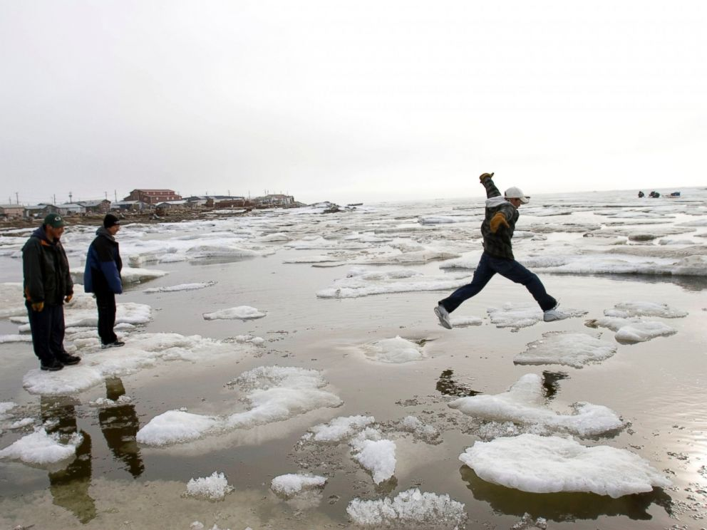 PHOTO: Teenage Inupiat Eskimos go ice-hoping on the Chukchi Sea at 1 am, one of the rare distractions in Shishmaref, June 10, 2005, in Shishmaref, Alaska.