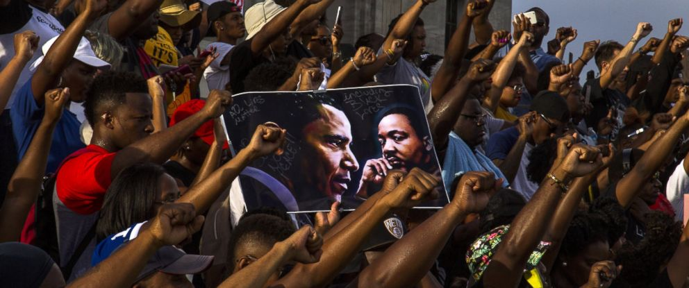 PHOTO: Demonstrators gather after marching at the Louisiana Capitol to protest the shooting of Alton Sterling on July 9, 2016 in Baton Rouge, Louisiana.