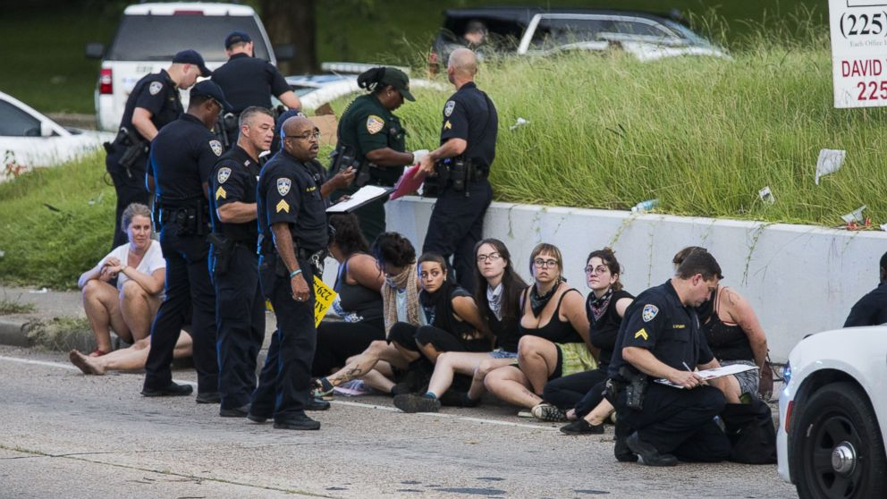 Several arrested protesters get processed on the scene after a march on July 10, 2016 in Baton Rouge, Louisiana.