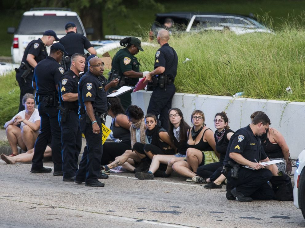 PHOTO: Several arrested protesters get processed on the scene after a march on July 10, 2016 in Baton Rouge, Louisiana.