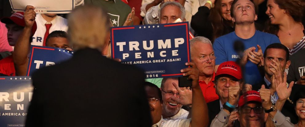 PHOTO: Former Congressman Mark Foley sits in the audience as Republican presidential nominee Donald Trump looks back at the crowd during his campaign event at the BB&T Center on August 10, 2016 in Fort Lauderdale, Florida. Photo by Joe Raedle/Getty Images
