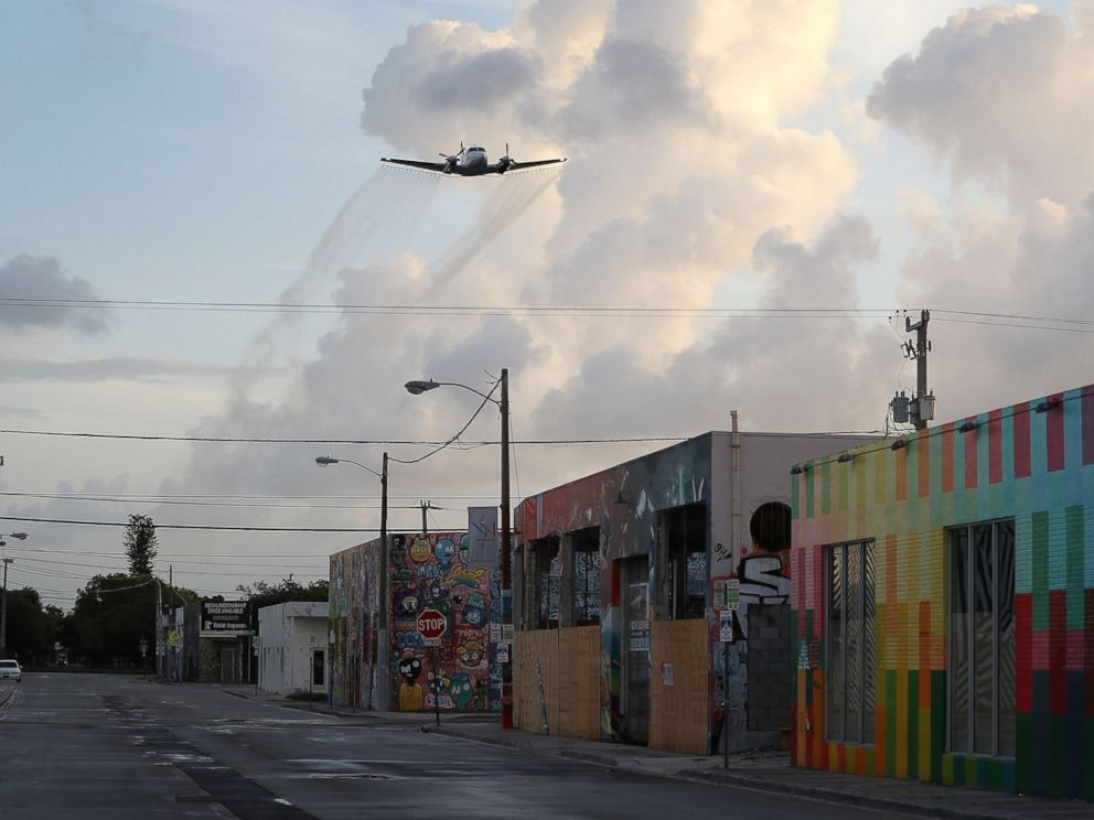 PHOTO: A plane sprays pesticide over the Wynwood neighborhood in the hope of controlling and reducing the number of mosquitos, some of which may be capable of spreading the Zika virus
