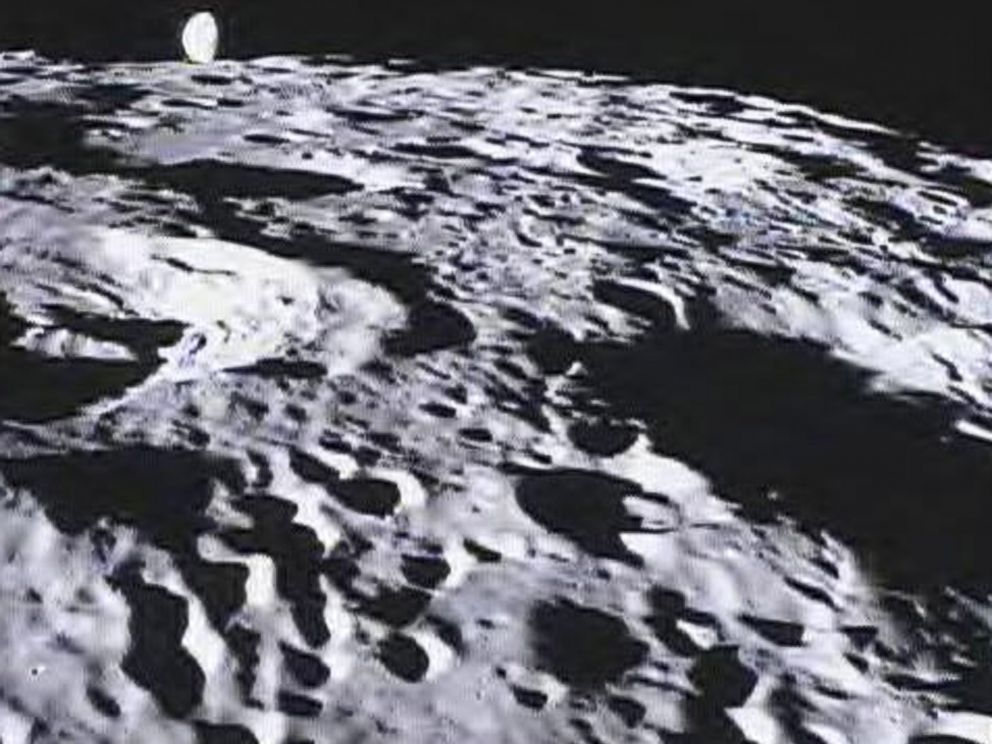 PHOTO: Image of the far side of the lunar surface, with Earth in the background, taken by NASAs MoonKAM system onboard the Ebb spacecraft.