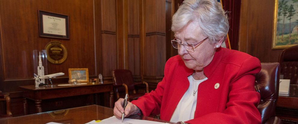 PHOTO: Alabama Governor Kay Ivey signs the Alabama Human Life Protection Act, after both houses of the Alabama Legislature passed HB314, May 15, 2019.