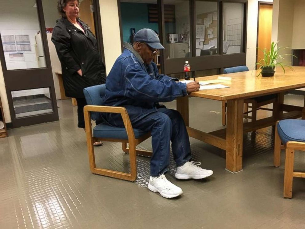 In a photo provided by the Nevada Department of Correction, Simpson is seen signing paperwork upon his release from prison Sunday, Oct. 1, 2017.