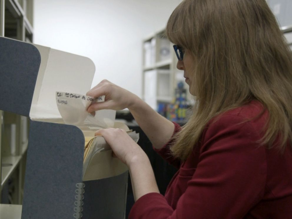 PHOTO: Historian Samantha Bradbeer looking through company archive.