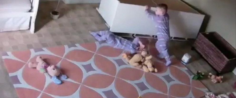 PHOTO: Video footage shows the dresser falling and trapping one child while his twin pushed and moved the dresser until his sibling was free.