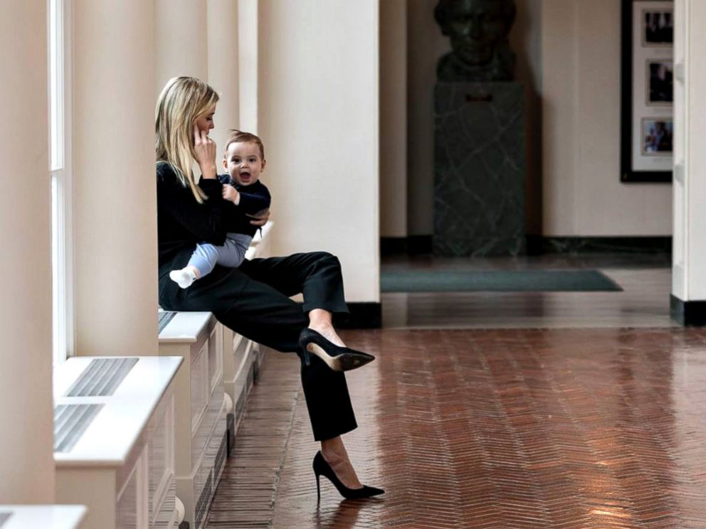 PHOTO: Holding her youngest son Theodore, Ivanka Trump talks on the phone in the East Colonnade of the White House, Jan. 29, 2017, in Washington.