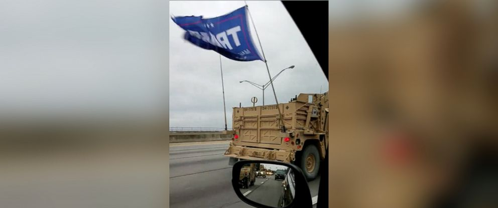 PHOTO: Image taken from video showing a convoy of military vehicles that was spotted on Interstate 65 outside of Louisville, Kentucky, flying a flag in support of President Donald Trump, January 29, 2017.