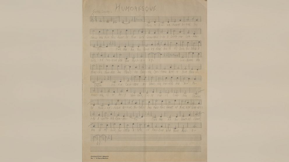 Handwritten musical manuscript of 'Humoresque,' unsigned, written in pencil by Al Capone, while at Alcatraz, on an off-white 9.5 x 12.55 musically lined sheet.