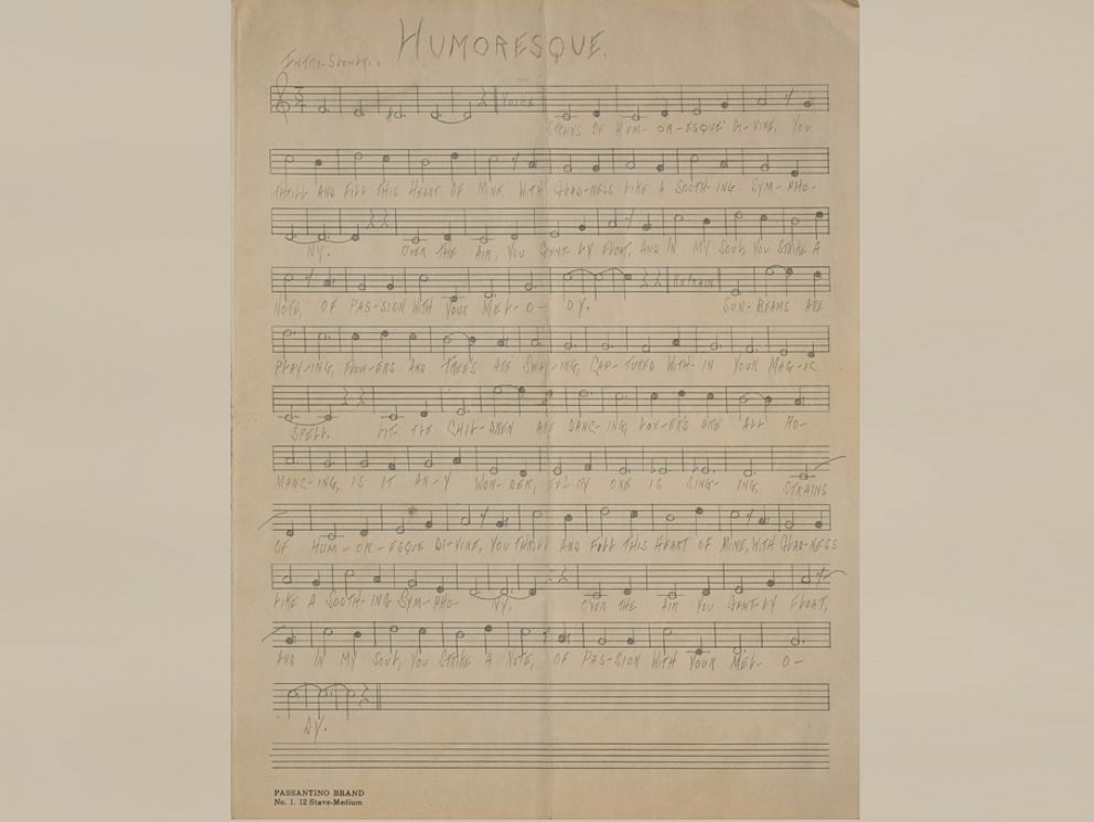 PHOTO: Handwritten musical manuscript of Humoresque, unsigned, written in pencil by Al Capone, while at Alcatraz, on an off-white 9.5 x 12.55 musically lined sheet.