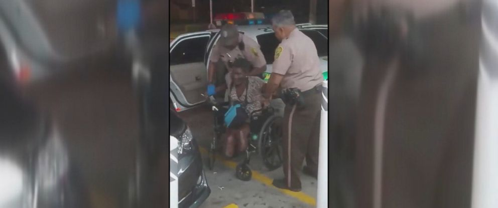 PHOTO: Cell phone video recorded by a witness at a Chevron gas station in Miami-Dade County, Florida, captured the moment a woman in a wheelchair with a double amputation fell to the ground while being handcuffed by police on Dec. 3, 2016.