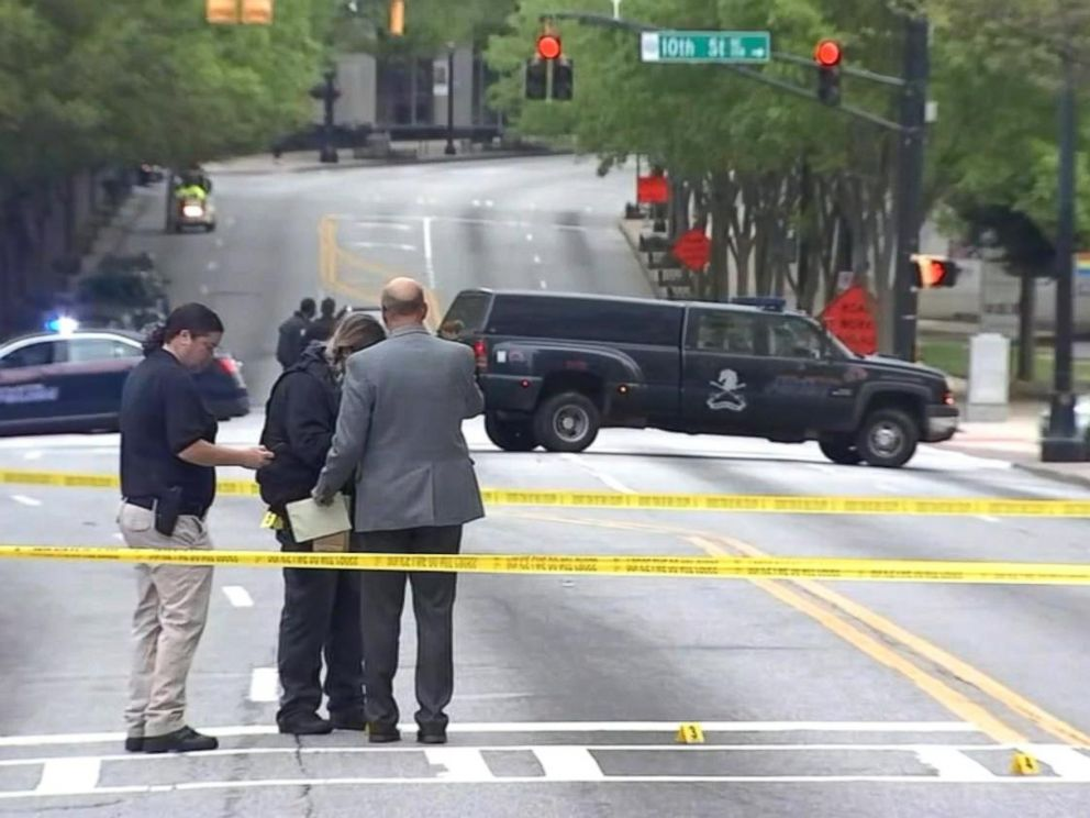 PHOTO: This still from video shows police investigating the targeted killing of a woman in broad daylight by a gunman on a busy Midtown Atlanta street, Apr. 3, 2017.