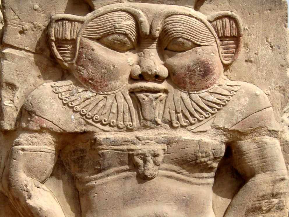 PHOTO: Relief of the god Bes next to the Roman north gate of the temple complex of Dendera, Egypt.