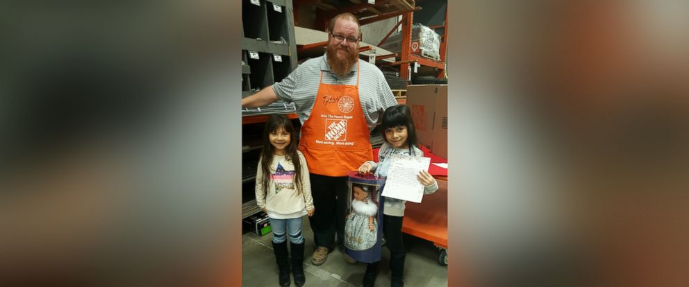 PHOTO: Adrianna Escamilla and her twin sister, Lillyanne, pose with Home Depot store manager Tyson Manuele.