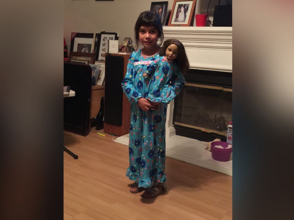 PHOTO: Adrianna Escamilla holds her beloved doll, Katy, prior to leaving the doll behind at a local Home Depot store.