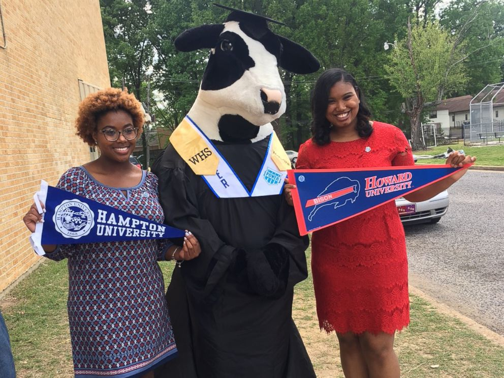 PHOTO: MacKenzie Walker, left, holds up her Hampton University banner, while her classmate, Cassietta Jones, right, holds up her Howard University banner.