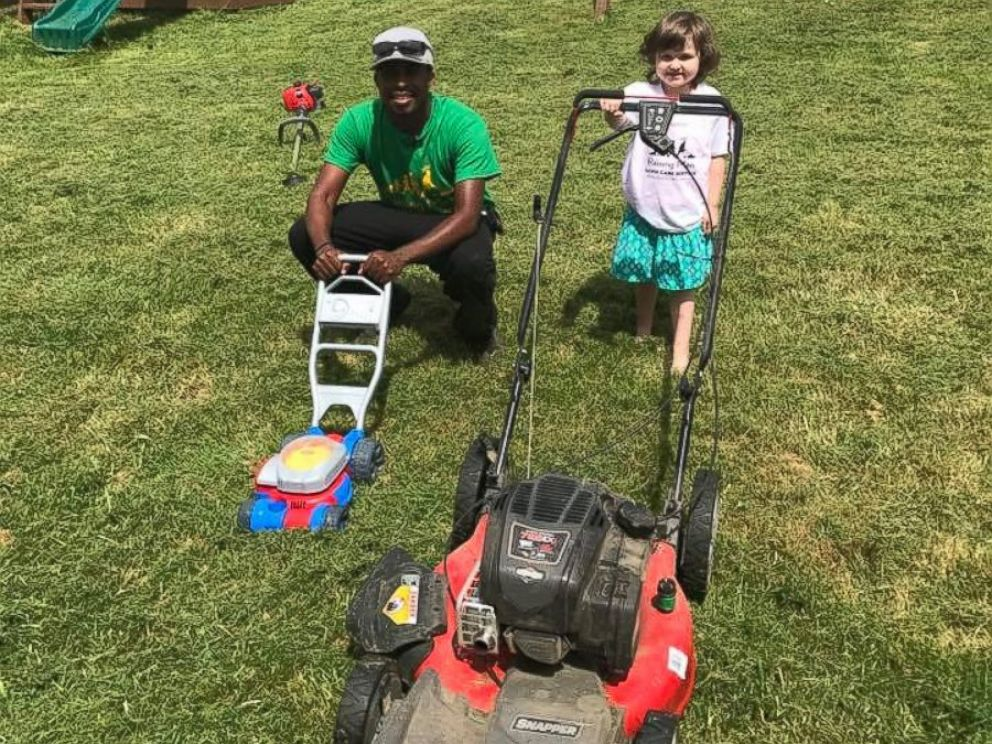photo raising men lawn care service mows lawns for free for elderly and disabled people