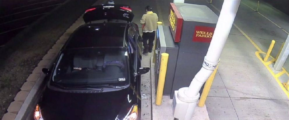 PHOTO: Surveillance footage shows a woman being forced into the trunk of her car at a bank in Arlington, Texas, Jan. 14, 2015.