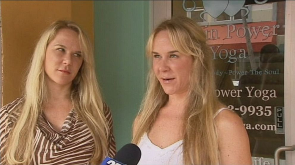 In this undated file photo, Alexandria Duval and her identical twin sister, Anastasia Duval, are interviewed in front of their former yoga studio.