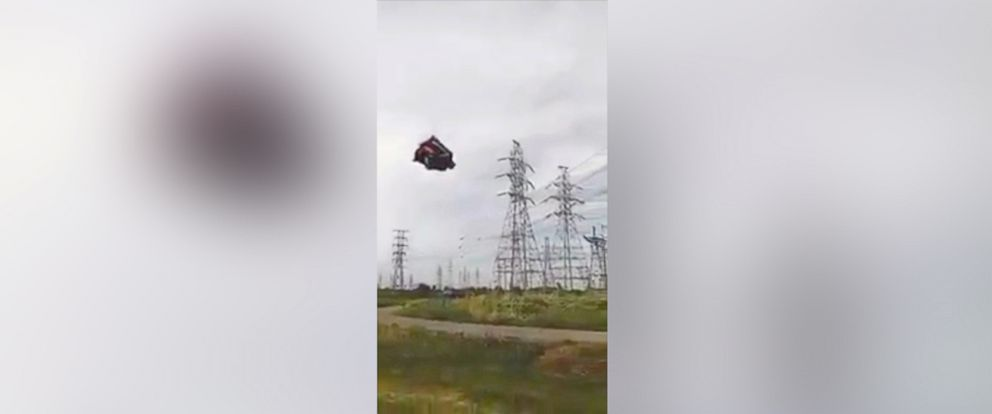 PHOTO: Strong winds send a bounce house into the air at a birthday party.