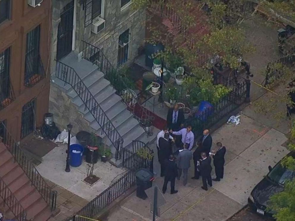 PHOTO: Police investigate a crime scene in Brooklyn, New York, where an elderly couple was robbed on Wednesday.