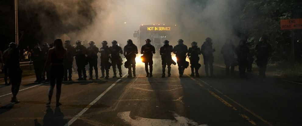 PHOTO: Police line up in front of protesters in Charlotte, North Carolina, Sept. 21, 2016.