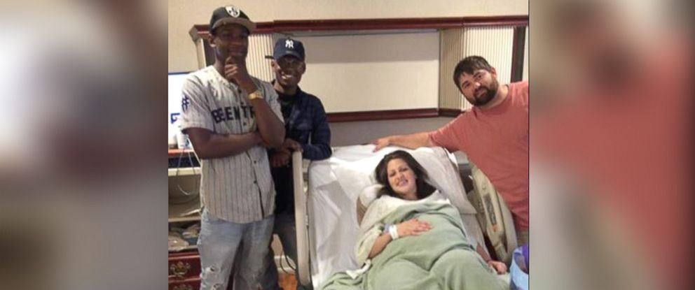 PHOTO: Deorick Williams and his brother Dennis meet new parents they met through a wrong number.