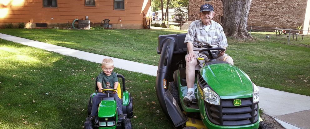 PHOTO: Erling, left, and Emmett pose for a picture in their matching tractors.