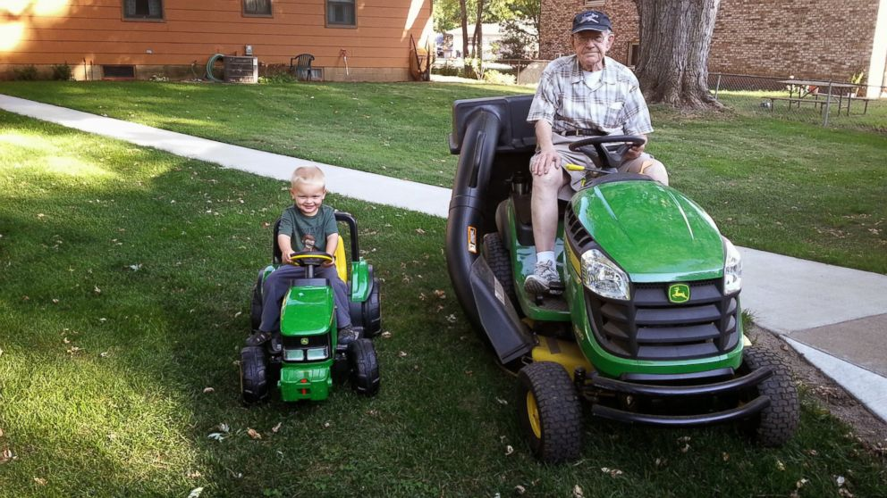 Emmett, left and Erling pose for a picture in their matching tractors.