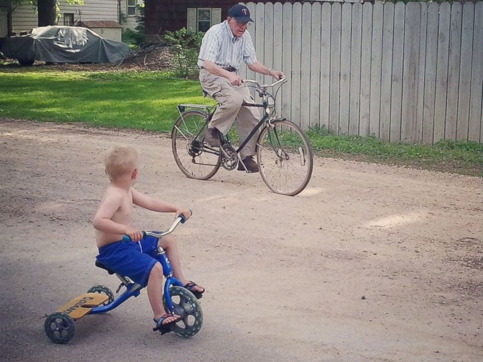 PHOTO: Erling and Emmett biking together near the house.