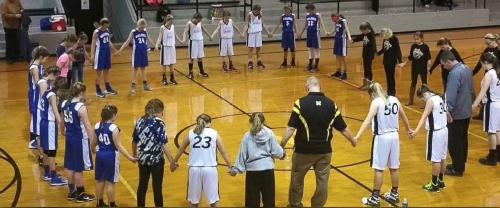 PHOTO:The American Humanist Association sent a letter of complaint to two Shelby Eastern Schools after a photo of the two teams praying with a coach was posted online.